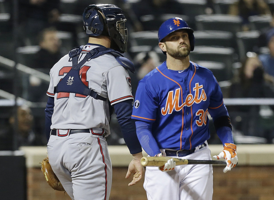Photo - New York Mets' Andrew Brown reacts after striking out during the seventh inning of a baseball game against the Atlanta Braves, Friday, April 18, 2014, in New York. (AP Photo/Frank Franklin II)