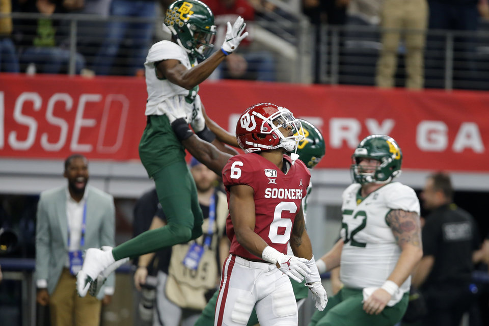 Photo - Baylor celebrates a touchdown behind Oklahoma's Tre Brown (6) during the Big 12 Championship Game between the University of Oklahoma Sooners (OU) and the Baylor University Bears at AT&T Stadium in Arlington, Texas, Saturday, Dec. 7, 2019. [Bryan Terry/The Oklahoman]