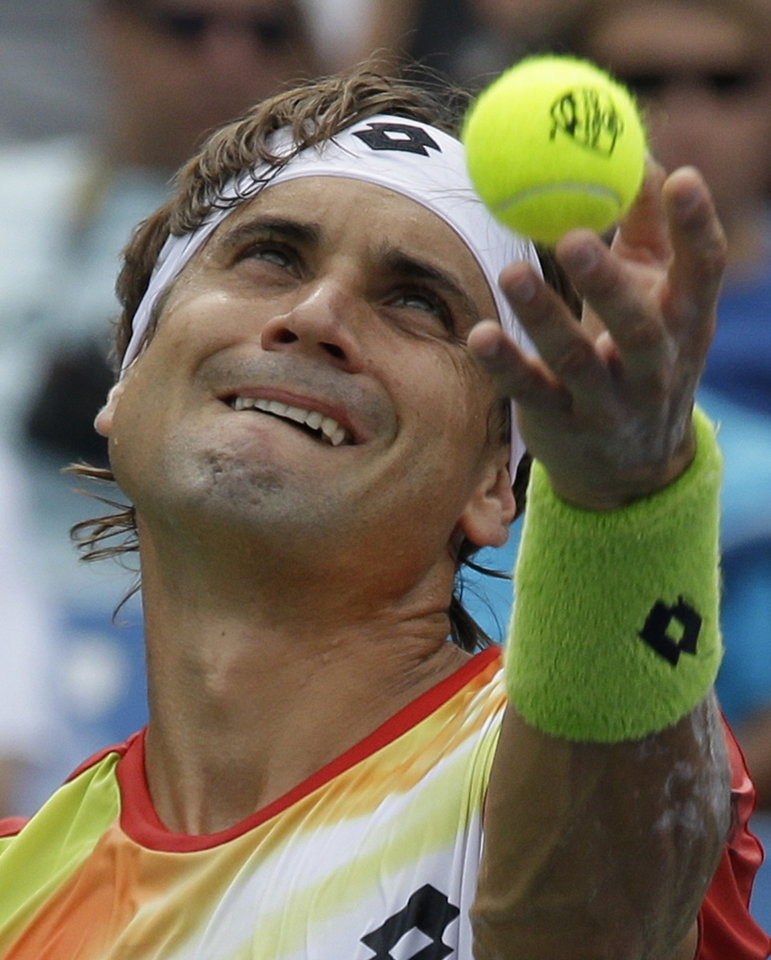 Photo - David Ferrer, from Spain, serves against Roger Federer, from Switzerland, during a final match at the Western & Southern Open tennis tournament, Sunday, Aug. 17, 2014, in Mason, Ohio. (AP Photo/Al Behrman)