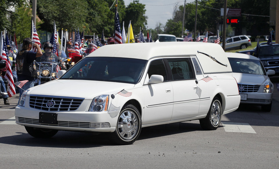 Photo - A hearse leaves the Downtown Pentecostal Church in Shawnee, Tuesday. Photo By Steve Gooch, The Oklahoman