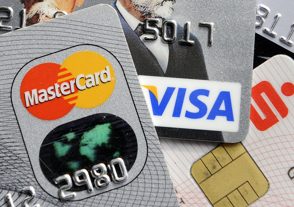 Photo - FILE - This Nov. 18, 2009 file photo shows credit and bank cards with electronic chips in Gelsenkirchen, Germany. In the wake of recent high-profile data breaches, including this week's revelation that hackers stole consumer data from eBay's computer systems, Visa and MasterCard are renewing a push to speed the adoption of microchips into U.S. credit and debit cards. (AP Photo/Martin Meissner, File)