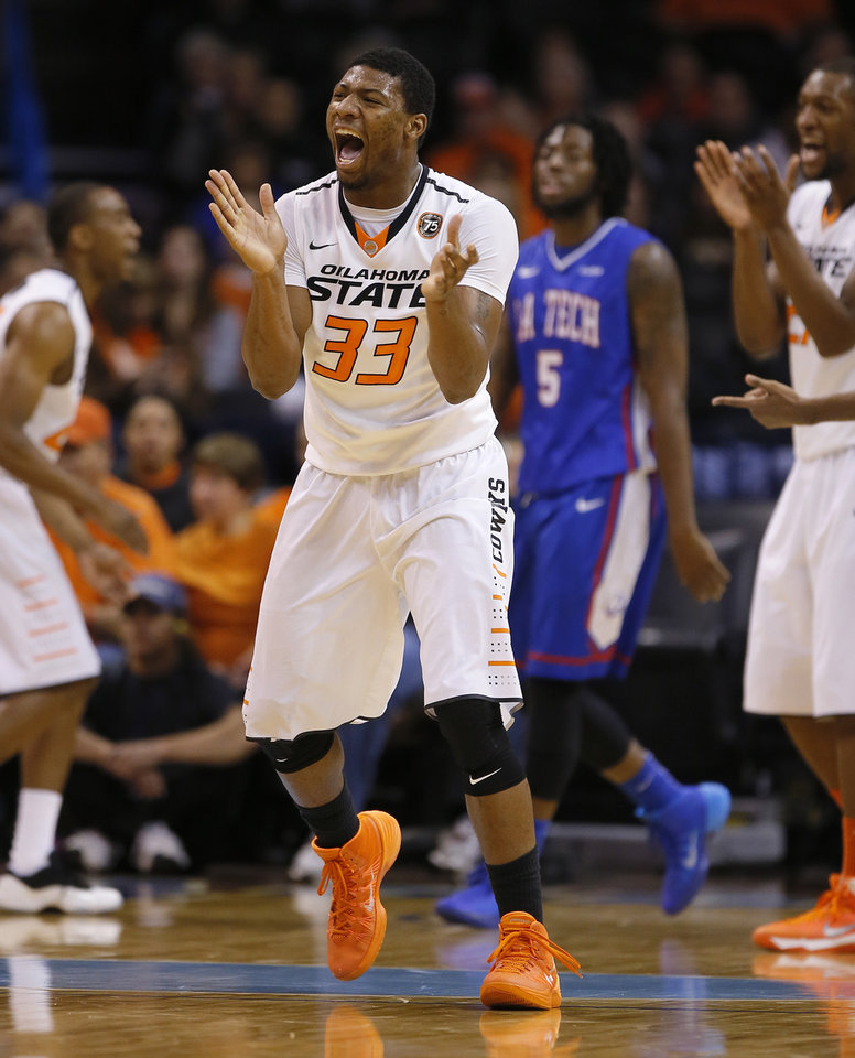 Oklahoma State's Marcus Smart (33) reacts during the All-College Classic basketball game between Oklahoma State University and Louisiana Tech at Chesapeake Energy Arena in Oklahoma City, Okla., Saturday, Dec. 14, 2013. Photo by Bryan Terry, The Oklahoman