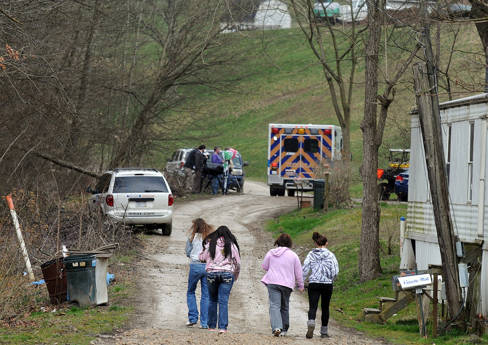 "Photo - Friends and neighbors walk up and down the gravel road leading to Shain Gandee's home in Sissonville, W.Va., Monday afternoon, April 1, 2013. Gandee, star of the MTV show ""Buckwild""; his uncle, David Gandee; and Donald Robert Myers were found dead in the family's Ford Bronco Monday morning. (AP Photo/The Charleston Gazette, Chip Ellis)"