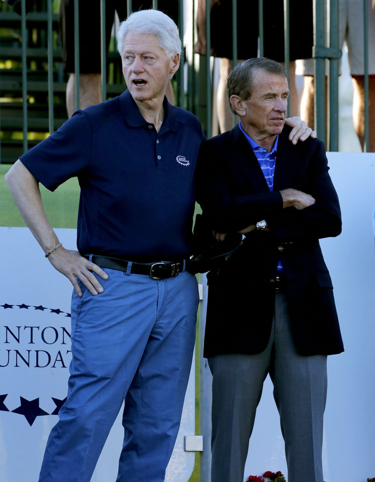 Photo - Former President Bill Clinton, left, stands with PGA Tour Commissioner Tim Finchem prior to the start of the first round of the Humana Challenge PGA golf tournament on the Palmer Private course at PGA West, Thursday, Jan. 16, 2014, in La Quinta, Calif.  (AP Photo/Matt York)