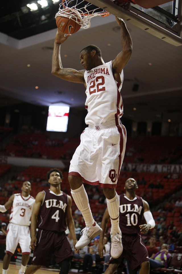 Photo - Oklahoma's Amath M'Baye (22) dunks during a men's college basketball game between the University of Oklahoma and the University of Louisiana-Monroe at the Loyd Noble Center in Norman, Okla., Sunday, Nov. 11, 2012.  Photo by Garett Fisbeck, The Oklahoman