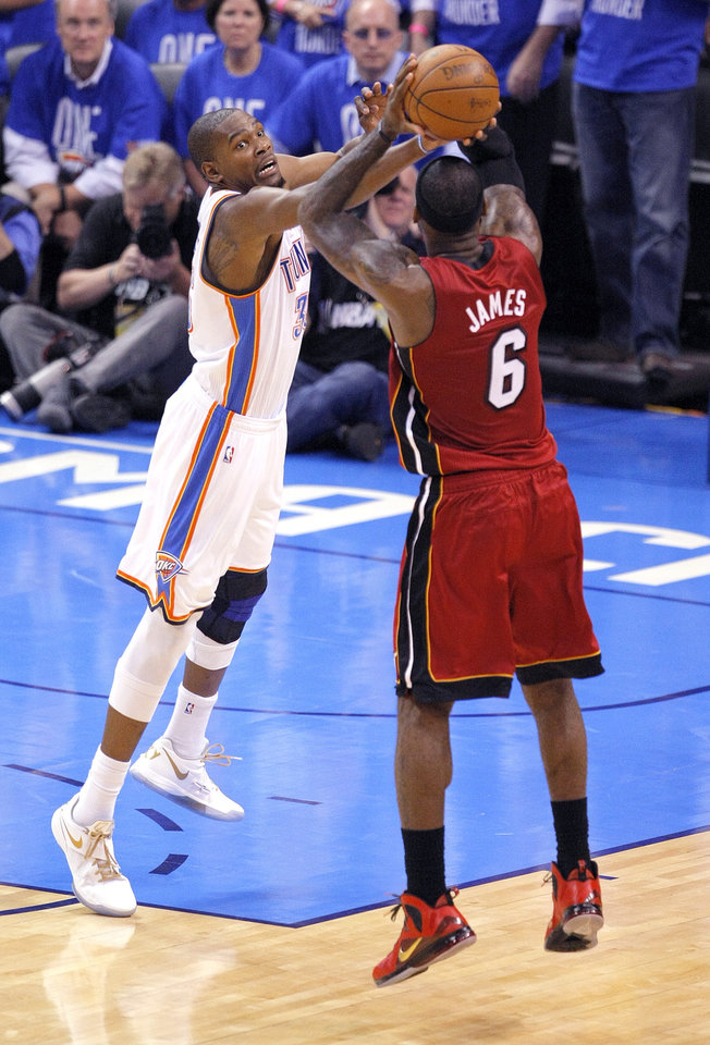 Oklahoma City's Kevin Durant (35) defends against Miami's LeBron James (6) during Game 1 of the NBA Finals between the Oklahoma City Thunder and the Miami Heat at Chesapeake Energy Arena in Oklahoma City, Tuesday, June 12, 2012. Photo by Sarah Phipps, The Oklahoman