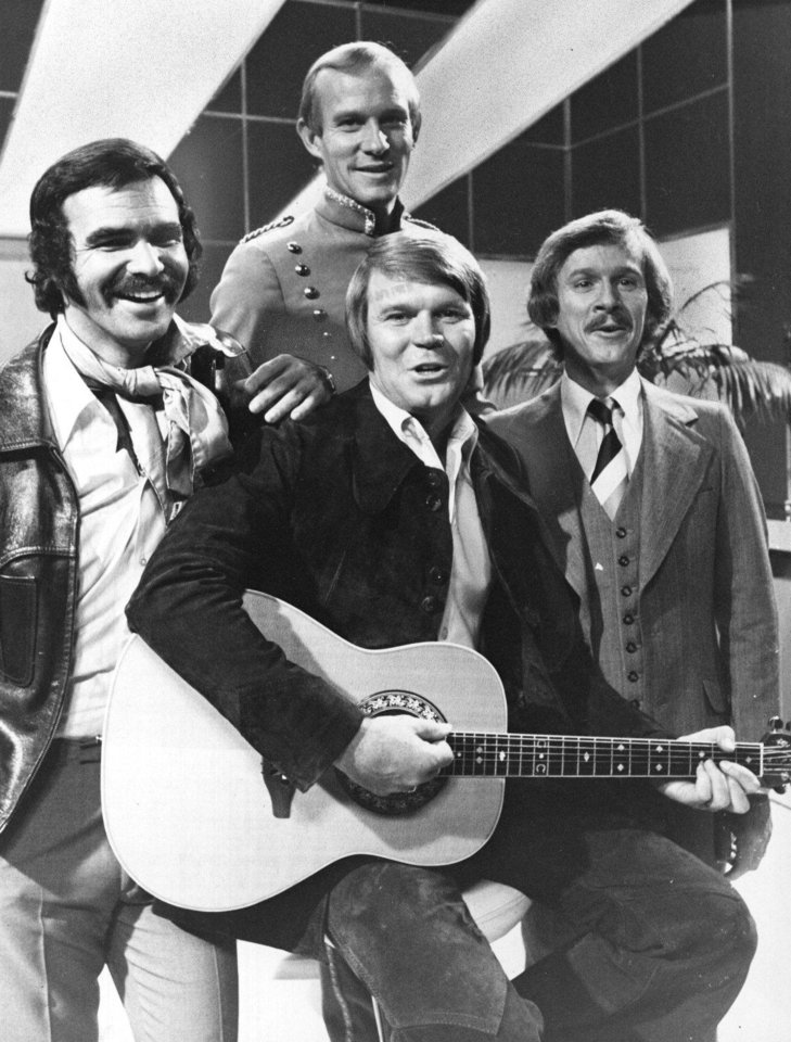 Photo - Glen Campbell, center, shares spotlight with Burt Reynolds, left, Tom Smothers and his brother Dick. (Original photo ran 09/16/73)