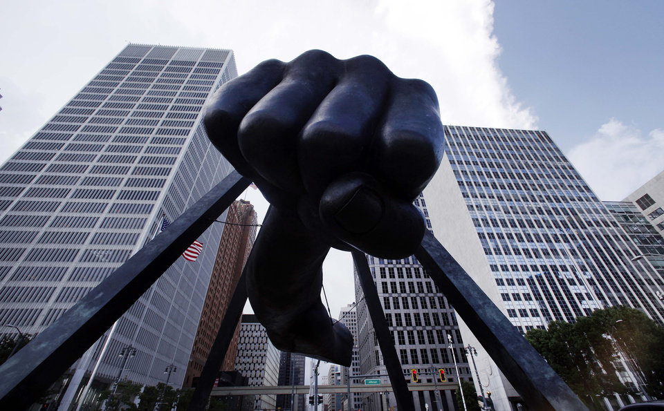 "The Detroit skyline rises behind the Monument to Joe Louis, also known as ""The Fist,"" Thursday, July 18, 2013. State-appointed emergency manager Kevyn Orr asked a federal judge permission to place Detroit into Chapter 9 bankruptcy protection. (AP Photo/Paul Sancya)"