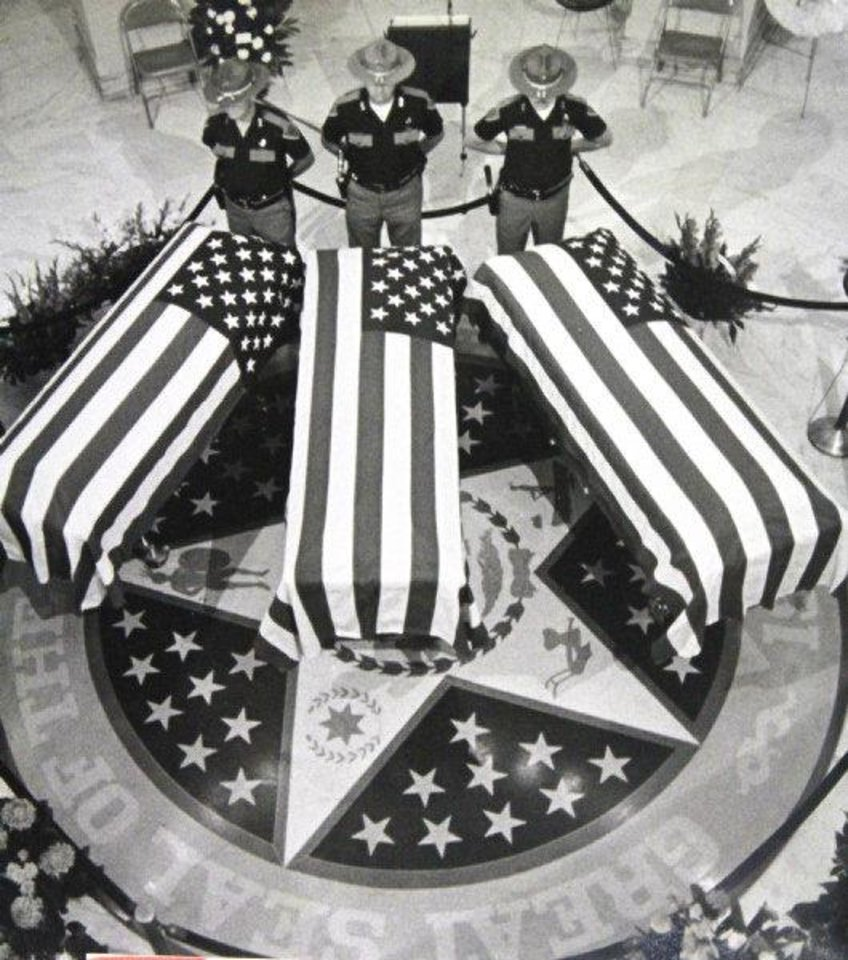 Photo - Troopers at the state Capitol guard the flag-draped caskets of three Oklahoma troopers who were killed in 1978 while trying to apprehend two escapees. OKLAHOMAN ARCHIVE PHOTO