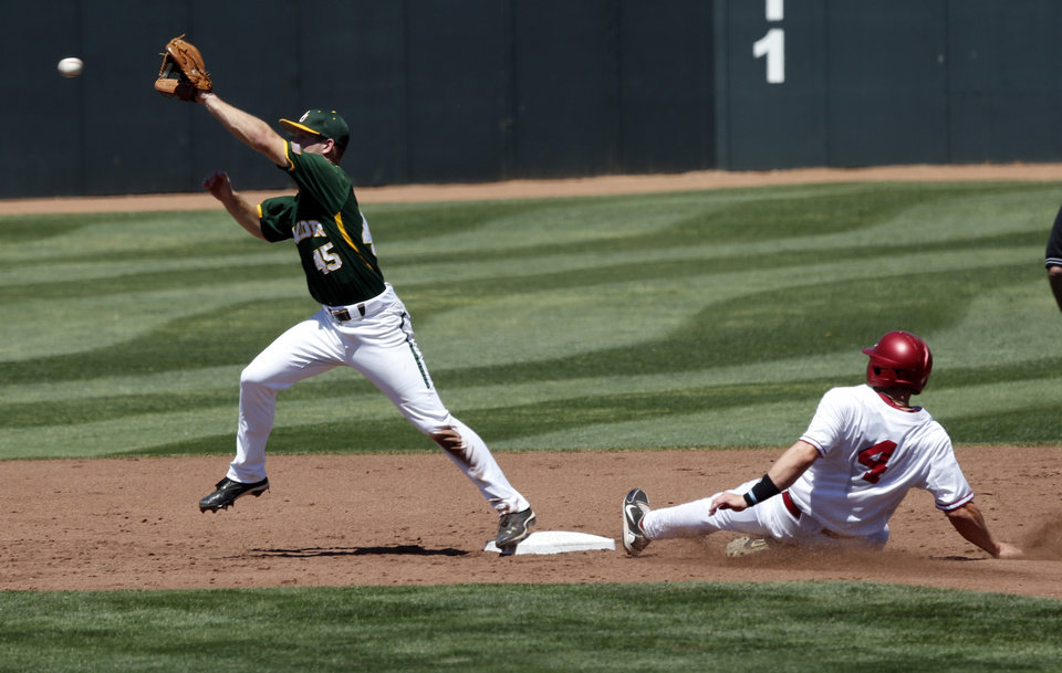 Photo - Oklahoma's Hunter Haley (4) is out at second with a catch by Hayden Ross as the University of Oklahoma Sooner (OU) baseball team plays the Baylor Bears in college baeball at L. Dale Mitchell Park on May 3, 2014 in Norman, Okla. Photo by Steve Sisney, The Oklahoman