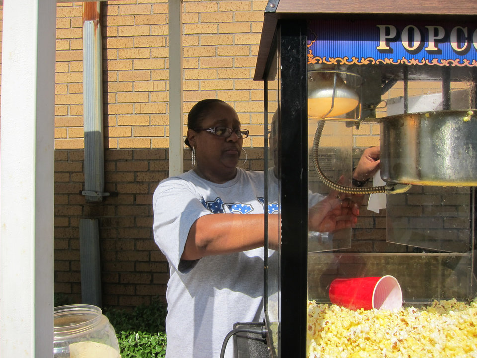 "Photo -  Greater Marshall Memorial Baptist Church volunteer Sharlen Carter makes popcorn during the ""Lunch and Learn in the Village"" community outreach at the church, 3045 NE 16. Photo by Carla Hinton, The Oklahoman"