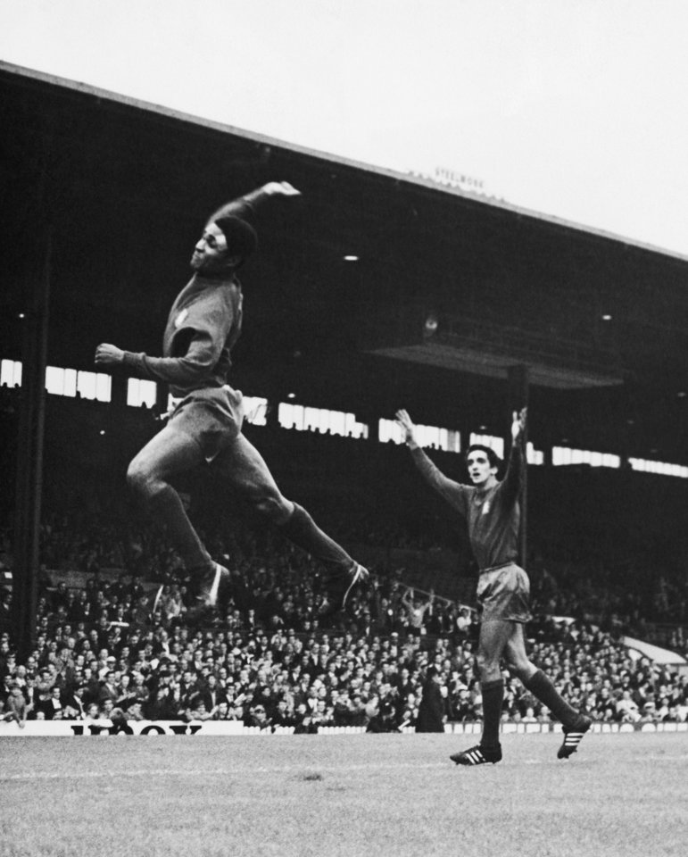 Photo - FILE - In this July 16, 1966 file photo, Eusebio jumps high after scoring Portugal's second goal in their World Cup soccer match against Bulgaria in Manchester, England. Portugal won the match 3-0. Eusebio, the Portuguese football star who was born into poverty in Africa but became an international sporting icon and was voted one of the 10 best players of all time, has died of heart failure aged 71, Sunday, Jan. 5 2014. (AP Photo/Bippa, File)