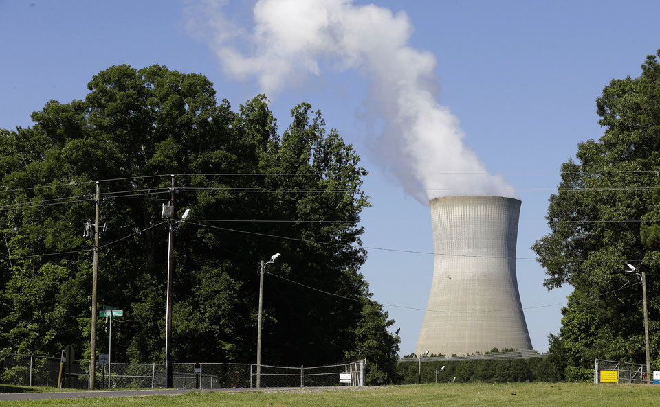 Photo - FILE - This file photo taken Friday, June 14, 2013 shows the Shearon Harris nuclear plant in Holly Springs, N.C. By court order, the Energy Department on Friday, May 16, 2014 will stop charging a fee that electric customers have been paying for 31 years to fund a federal nuclear waste site that doesn't exist. It's only a small percentage of most customers' bills, but it adds up to $750 million a year. The fund now holds $37 billion. (AP Photo/Gerry Broome, File)