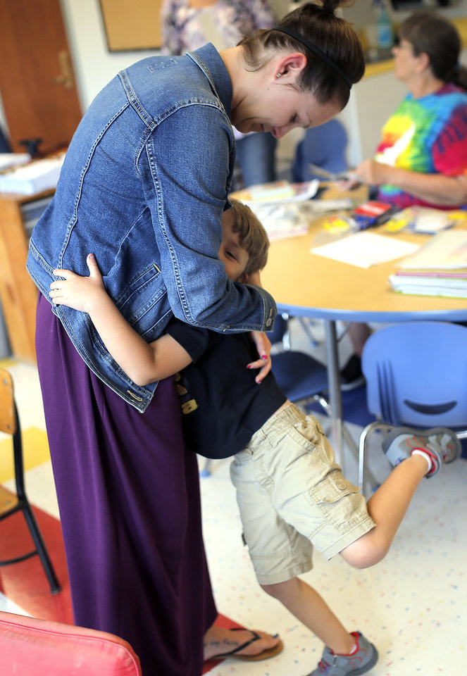Photo -  Cooper Stephens, 4, hugs his mom Johnna Kirkland after looking at the pre-K room Thursday at Wilson Elementary in Oklahoma City. Photo by Sarah Phipps, The Oklahoman   SARAH PHIPPS -