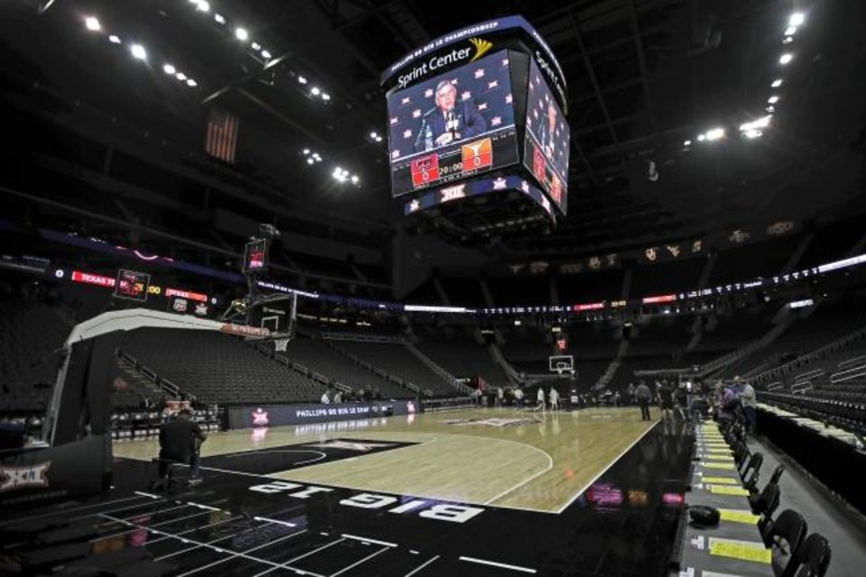 Photo -  Big 12 commissioner Bob Bowlsby is seen on the big screen in an empty Sprint Center as he talks to the media after canceling the remaining conference tournament basketball games March 12 in Kansas City, Mo. [AP Photo/Charlie Riedel]