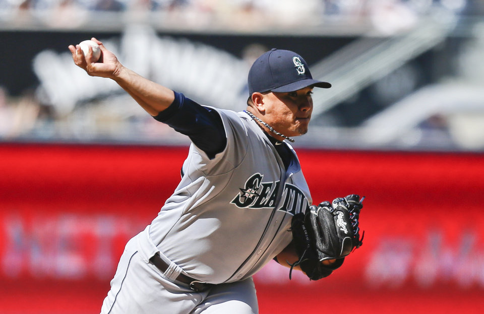 Photo - Seattle Mariners starting pitcher Erasmo Ramirez works against the San Diego Padres in the first inning of a baseball game, Thursday, June 19, 2014, in San Diego. (AP Photo/Lenny Ignelzi)