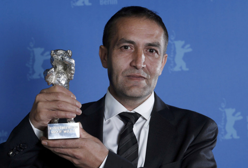 "Actor Nazif Mujic poses backstage with his Silver Bear award for Best Actor for the movie ""An Episode in the Life of an Iron Picker"" during the awards ceremony at the 63rd Berlinale International Film Festival in Berlin Saturday, Feb. 16, 2013. (AP Photo/Thomas Peter, pool)"