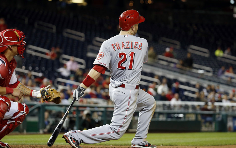 Cincinnati Reds' Todd Frazier watches his two-run homer during the 15th inning of a baseball game against the Washington Nationals at Nationals Park Monday, May 19, 2014, in Washington. The Reds won 4-3 in 15 innings. (AP Photo/Alex Brandon)