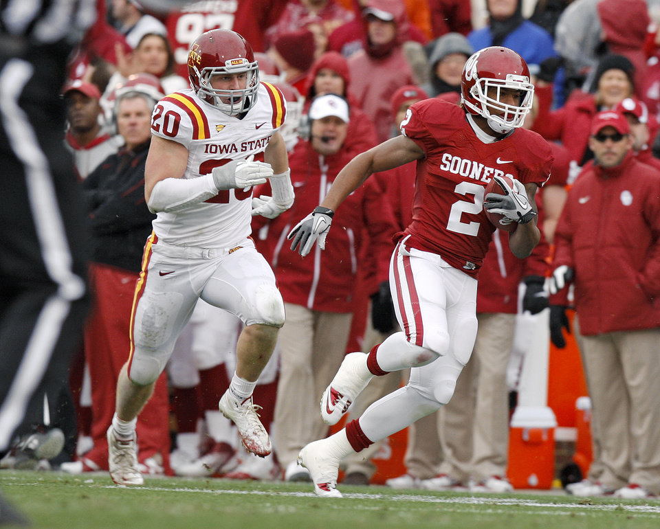 Photo - Oklahoma's Trey Franks (2) runs past Iowa State's Jake Knott (20) during a college football game between the University of Oklahoma Sooners (OU) and the Iowa State University Cyclones (ISU) at Gaylord Family-Oklahoma Memorial Stadium in Norman, Okla., Saturday, Nov. 26, 2011. Photo by Bryan Terry, The Oklahoman