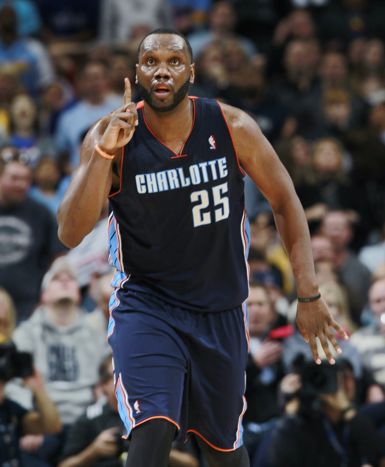 Photo - Charlotte Bobcats center Al Jefferson reacts after hitting key shot to put the Bobcats ahead of the Denver Nuggets late in the fourth quarter of the Bobcats' 101-98 victory in an NBA basketball game in Denver on Wednesday, Jan. 29, 2014. (AP Photo/David Zalubowski)