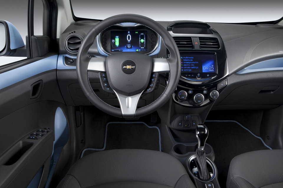 HOLD FOR RELEASE UNTIL 12:01AM TUESDAY, NOV. 26, 2012-This undated image provided by General Motors shows the 2014 Chevrolet Spark EV, which will be unveiled at the 2012 Los Angles Auto Show during the week of Nov. 26, 2012. With two re-configurable, HD, seven inch color LCD screens, the Spark EV features a customizable interface. (AP Photo/General Motors)