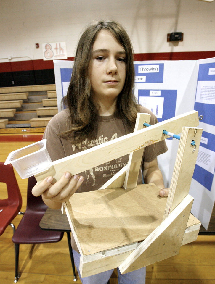 Photo - Eighth-grader Jason Perkins, 14, with the trebuchet he built for his science fair project at the Del Crest Middle School science fair in Del City Friday, Jan. 9, 2009.  PAUL B. SOUTHERLAND, THE OKLAHOMAN ORG XMIT: KOD