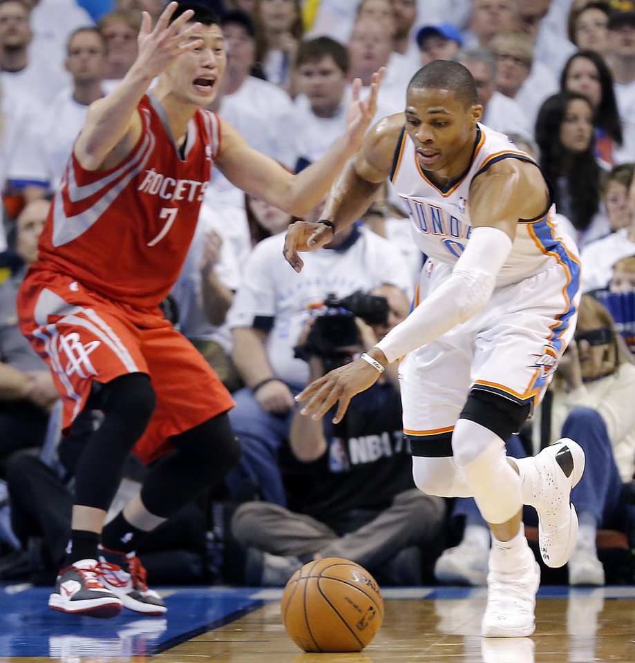 Oklahoma City's Russell Westbrook (0) gets a steal on Houston's Jeremy Lin (7) during Game 2 in the first round of the NBA playoffs between the Oklahoma City Thunder and the Houston Rockets at Chesapeake Energy Arena in Oklahoma City, Wednesday, April 24, 2013. Photo by Chris Landsberger, The Oklahoman