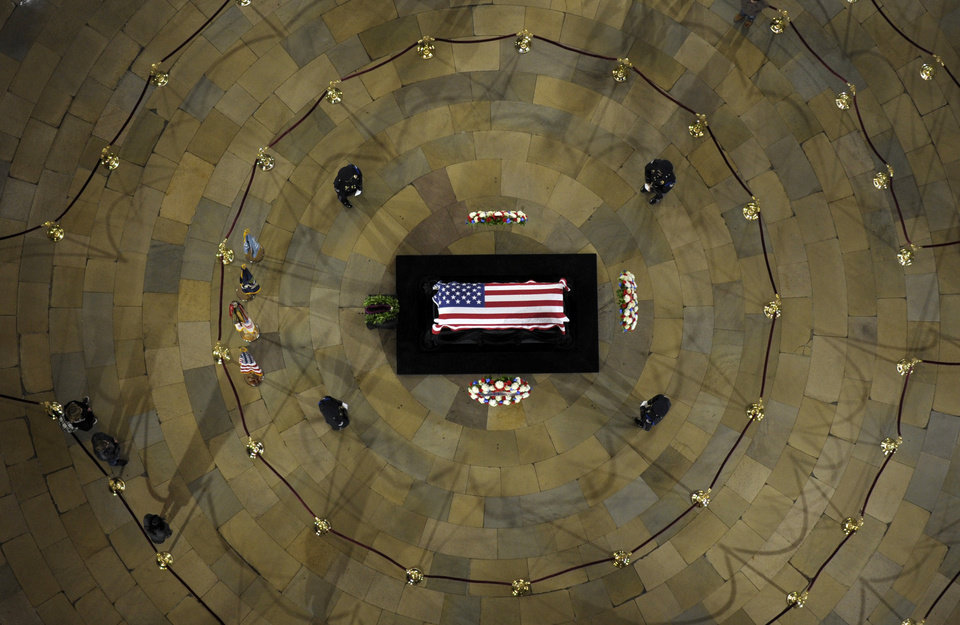 Photo - Sen. Daniel Inouye, D-Hawaii, the second-longest-serving senator in history, lies in state in the Capitol Rotunda in Washington, Thursday, Dec. 20, 2012. Inouye was a Medal of Honor recipient who represented his state in the U.S. House and then the Senate, where he served for five decades. He died Monday evening at age 88 of respiratory complications. (AP Photo/Susan Walsh)