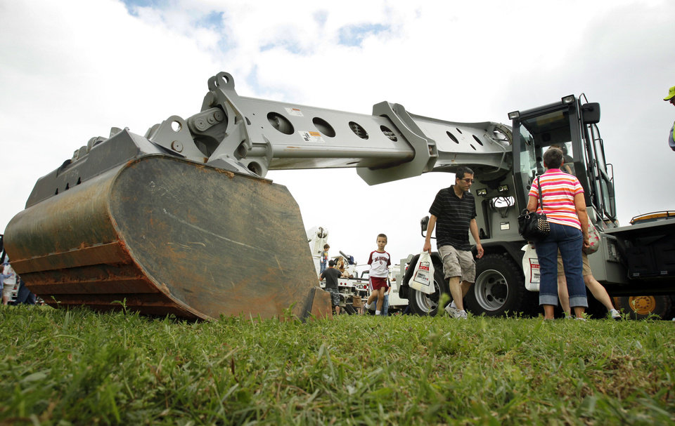"Parents, grandparents and children get an up-close look at a giant ditch digger at last year's ""Touch a Truck"" event. OKLAHOMAN ARCHIVES <strong>STEVE SISNEY</strong>"