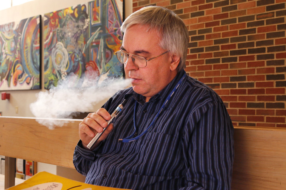 Photo - Todd Malicoate is a music professor at Oklahoma State University in Stillwater who uses an e-cigarette. Photo by Paul Hellstern, The Oklahoman