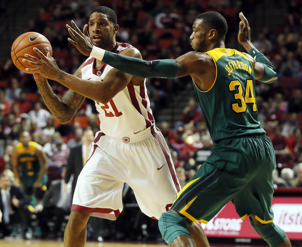 Photo - Oklahoma's Cameron Clark (21) passes the ball away from Baylor's Cory Jefferson (34) during an NCAA men's college basketball game between Baylor and the University of Oklahoma at Lloyd Noble Center in Norman, Okla., Saturday, Feb. 8, 2014. OU won, 88-72. Photo by Nate Billings, The Oklahoman