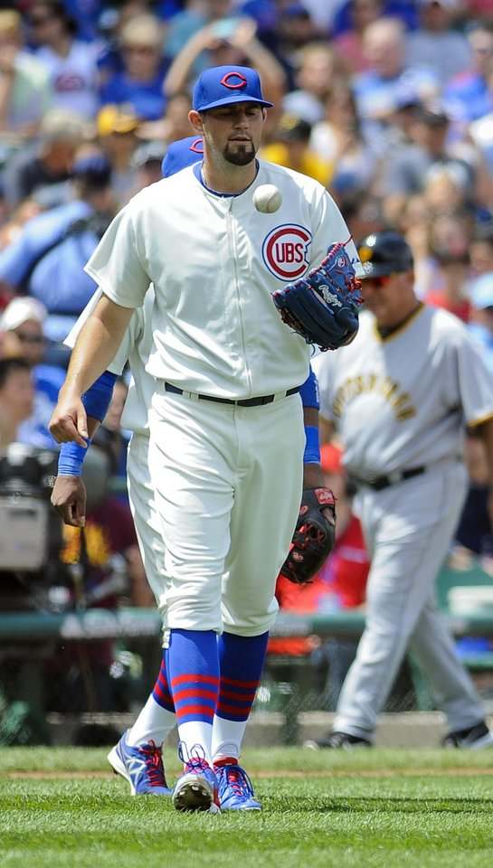Photo - Chicago Cubs starting pitcher Jason Hammel flips the ball after a run scored during the third inning of a baseball game against the Pittsburgh Pirates, on Sunday, June 22, 2014, in Chicago. (AP Photo/Matt Marton)
