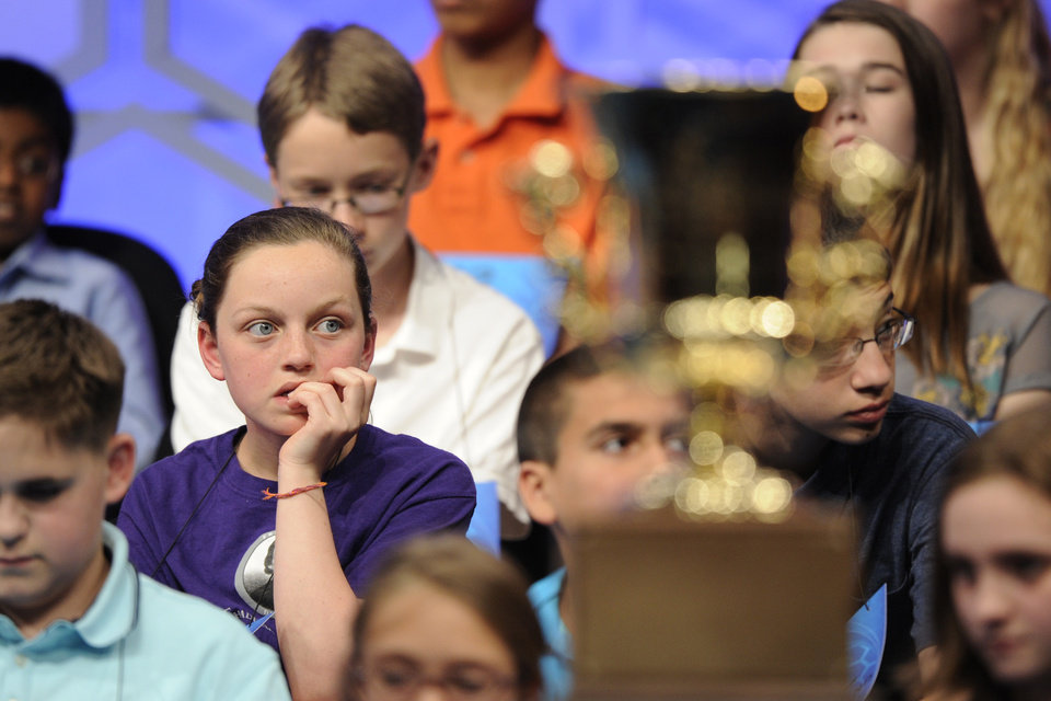 Photo - Lucinda Storz, 12, of Rutland, Vt, waits for her turn to spell a word during the 2015 Scripps National Spelling Bee in Oxon Hill, Md., Wednesday, May 27, 2015. (AP Photo/Cliff Owen)