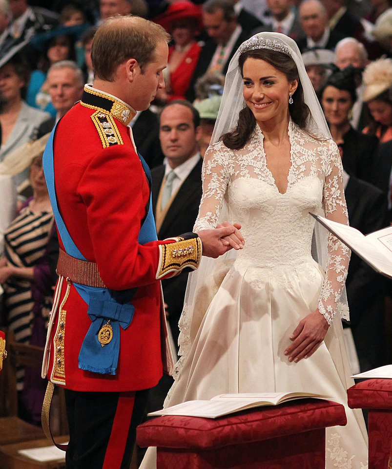 Photo - Britain's Prince William and his bride Kate Middleton exchange their vows during the wedding service at Westminster Abbey, London, Friday April 29, 2011. (AP Photo/Dominic Lipinski, Pool)
