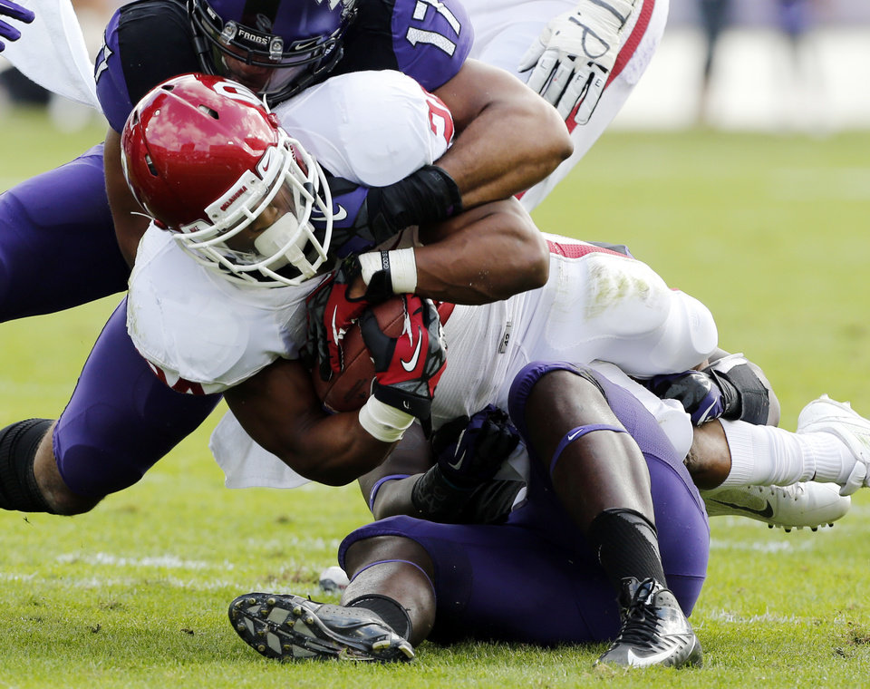 Oklahoma\'s Brennan Clay (24) runs as TCU\'s Sam Carter (17) brings him down during the college football game between the University of Oklahoma Sooners (OU) and the Texas Christian University Horned Frogs (TCU) at Amon G. Carter Stadium in Fort Worth, Texas, on Saturday, Dec. 1, 2012. Photo by Steve Sisney, The Oklahoman