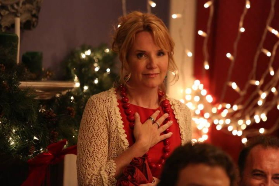 "Photo -  Lea Thompson is shown in a scene from ""Love at the Christmas Table."" - Lifetime Photo"