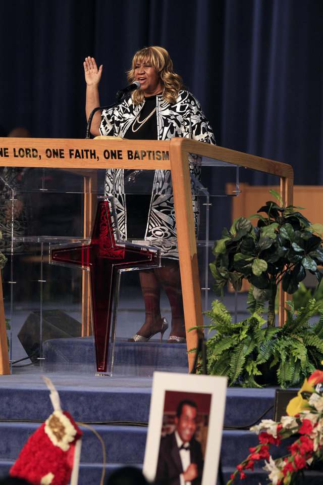 Aretha Franklin sings during a funeral service for the late famed boxing trainer Emanuel Steward at the Greater Grace Temple in Detroit, Tuesday, Nov. 13, 2012. (AP Photo/Carlos Osorio)
