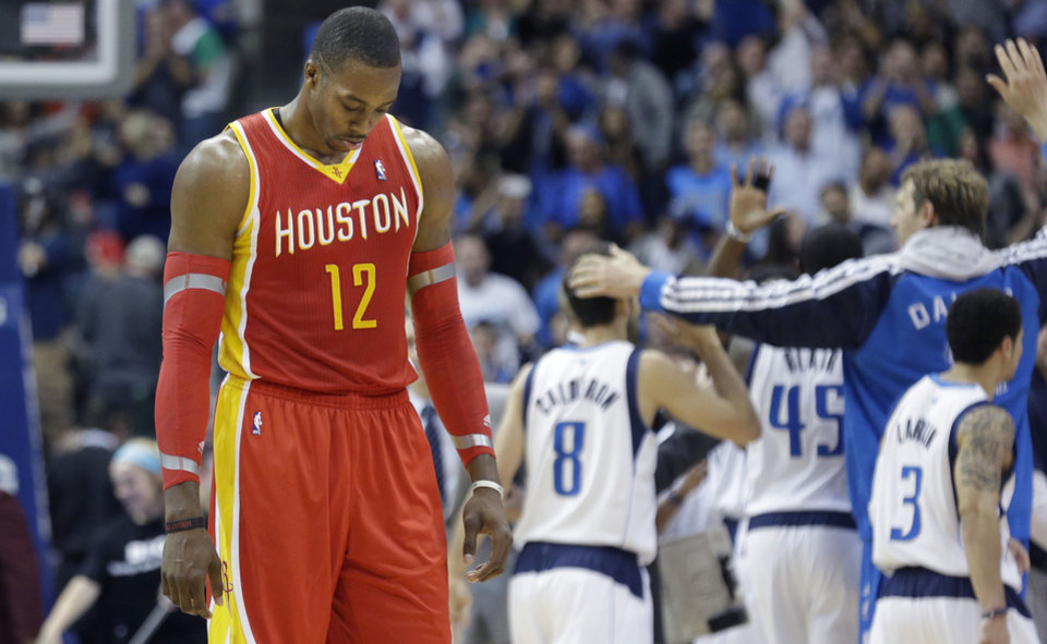 Houston Rockets forward Dwight Howard (12) hangs his head as he walks to  the bench during a time out in the fourth quarter of an NBA basketball game against the Dallas Mavericks in Dallas,  Wednesday, Nov. 20, 2013. The Mavericks won 123-120.   (AP Photo/LM Otero)