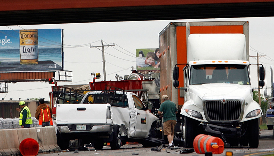 The driver of a pickup was injured at an accident between a northbound eighteen-wheel truck and a pickup on Interstate 35 in the construction zone under the Tecumseh Road overpass in Norman, Okla. on Tuesday, April 28, 2009. Photo by Steve Sisney, The Oklahoman