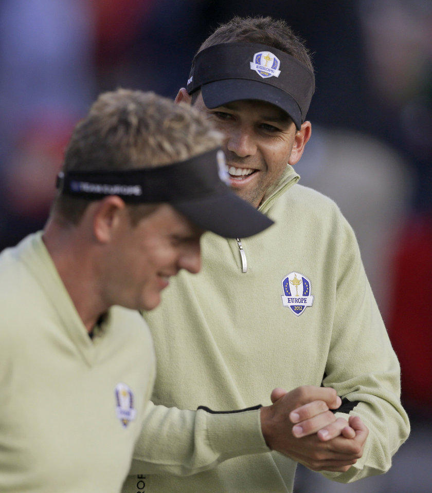 Photo -   Europe's Sergio Garcia and Luke Donald get ready to tee off on the first tee during a foursomes match at the Ryder Cup PGA golf tournament Friday, Sept. 28, 2012, at the Medinah Country Club in Medinah, Ill. (AP Photo/Chris Carlson)