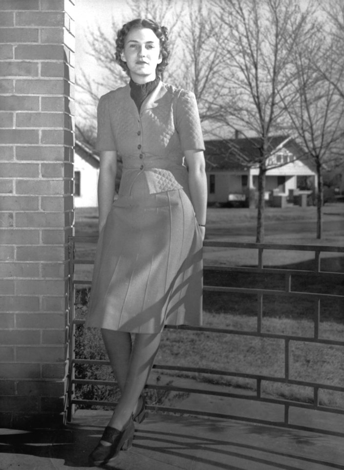 Former University of Oklahoma student Patience Sewell on the front porch of her home in Clinton, OK. Patience Sewell Latting would later become (in 1971) the first woman mayor of Oklahoma City. Staff photo by Betty Baughman taken 1/1/39.