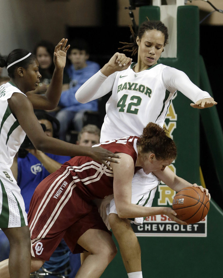 Photo - Oklahoma's Joanna McFarland, bottom, is stopped by Baylor's Brittney Griner (42) and Odyssey Sims during the first half of an NCAA basketball game Saturday, Jan. 26, 2013, in Waco Texas.  Baylor won 82-65. (AP Photo/LM Otero) ORG XMIT: TXMO113