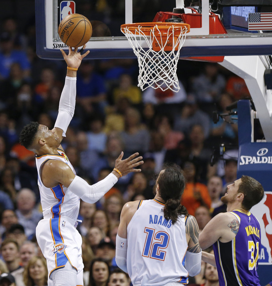 Photo - Oklahoma City's Russell Westbrook (0) shoots in the third quarter near Oklahoma City's Steven Adams (12) and Mike Muscala (31) during an NBA basketball game between the Los Angeles Lakers and the Oklahoma City Thunder at Chesapeake Energy Arena in Oklahoma City, Tuesday, April 2, 2019. Oklahoma City won 119-103. Photo by Nate Billings, The Oklahoman