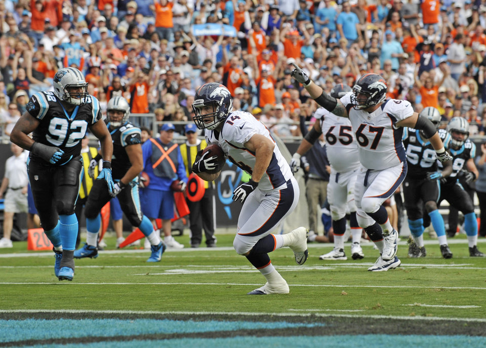 Photo -   Denver Broncos' Brandon Stokley (14) runs into the end zone for a touchdown against the Carolina Panthers during the first quarter of an NFL football game in Charlotte, N.C., Sunday, Nov. 11, 2012. (AP Photo/Rainier Ehrhardt)