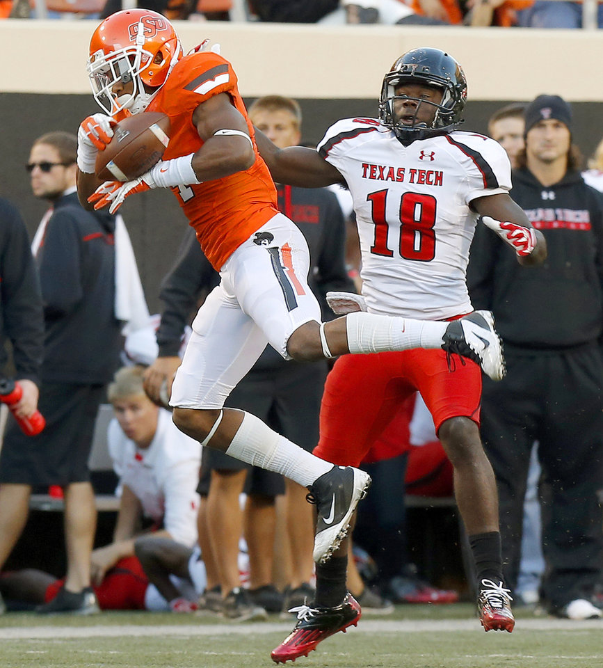 Photo - Oklahoma State's Justin Gilbert (4) breaks up a pass intended for Texas Tech's Eric Ward (18) during a college football game between Oklahoma State University (OSU) and Texas Tech University (TTU) at Boone Pickens Stadium in Stillwater, Okla., Saturday, Nov. 17, 2012.  Photo by Bryan Terry, The Oklahoman