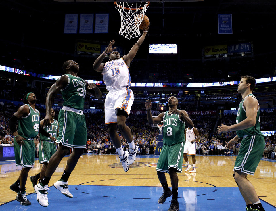 Oklahoma City's Reggie Jackson (15) goes up for a basket as through a host of Boston defenders over during the NBA game between the Oklahoma City Thunder and the Boston Celtics at the Chesapeake Energy Arena., Sunday, Jan. 5, 2014. Photo by Sarah Phipps, The Oklahoman