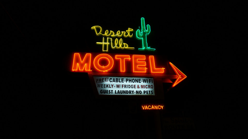 Photo -  @ty_the_videoguy   I snapped this picture one night while driving home from work. My girlfriend had mentioned we should drive down route 66 for a honeymoon. That's what brought the highway to my mind.  Plus, this is just a cool looking sign at night.