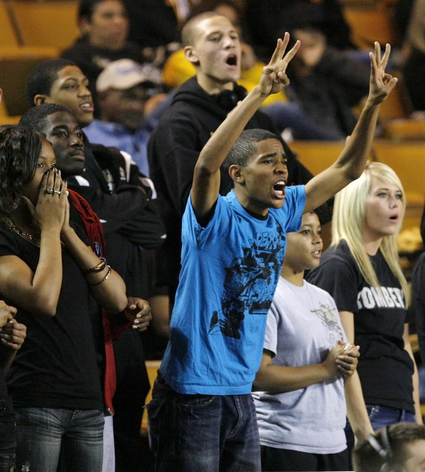 Photo - Midwest City fans root for the Lady Bombers during the Class 6A girls high school basketball state tournament final between Midwest City and Norman at the ORU Mabee Center in Tulsa, Okla., Saturday, March 13, 2010. Photo by Nate Billings, The Oklahoman