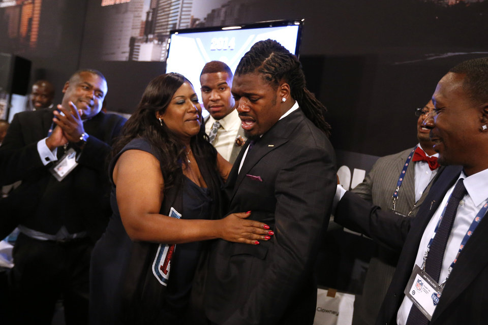 Photo - Jadeveon Clowney, from South Carolina, reacts with his mother Josenna Clowney after being selected number one overall by the Houston Texans in the first round of the NFL football draft, Thursday, May 8, 2014, at Radio City Music Hall in New York. (AP Photo/Jason DeCrow)