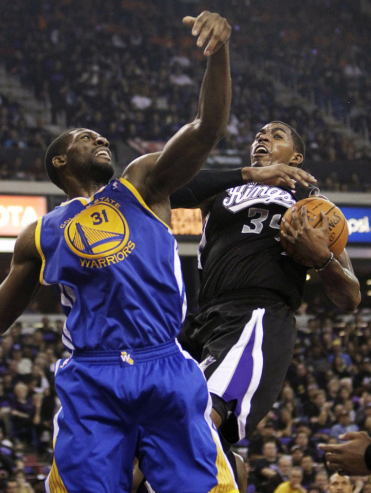Photo -   Sacramento Kings forward Jason Thompson, right, pulls the rebound away from Golden State Warriors center Festus Ezeli, of Nigeria, during the first half of an NBA basketball game in Sacramento, Calif., Monday, Nov. 5, 2012. (AP Photo/Rich Pedroncelli)